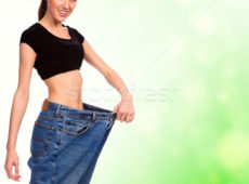 1948261_stock-photo-attractive-young-woman-shows-her-old-huge-pair-of-jeans