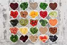 Diet detox super food selection in heart shaped porcelain bowls
